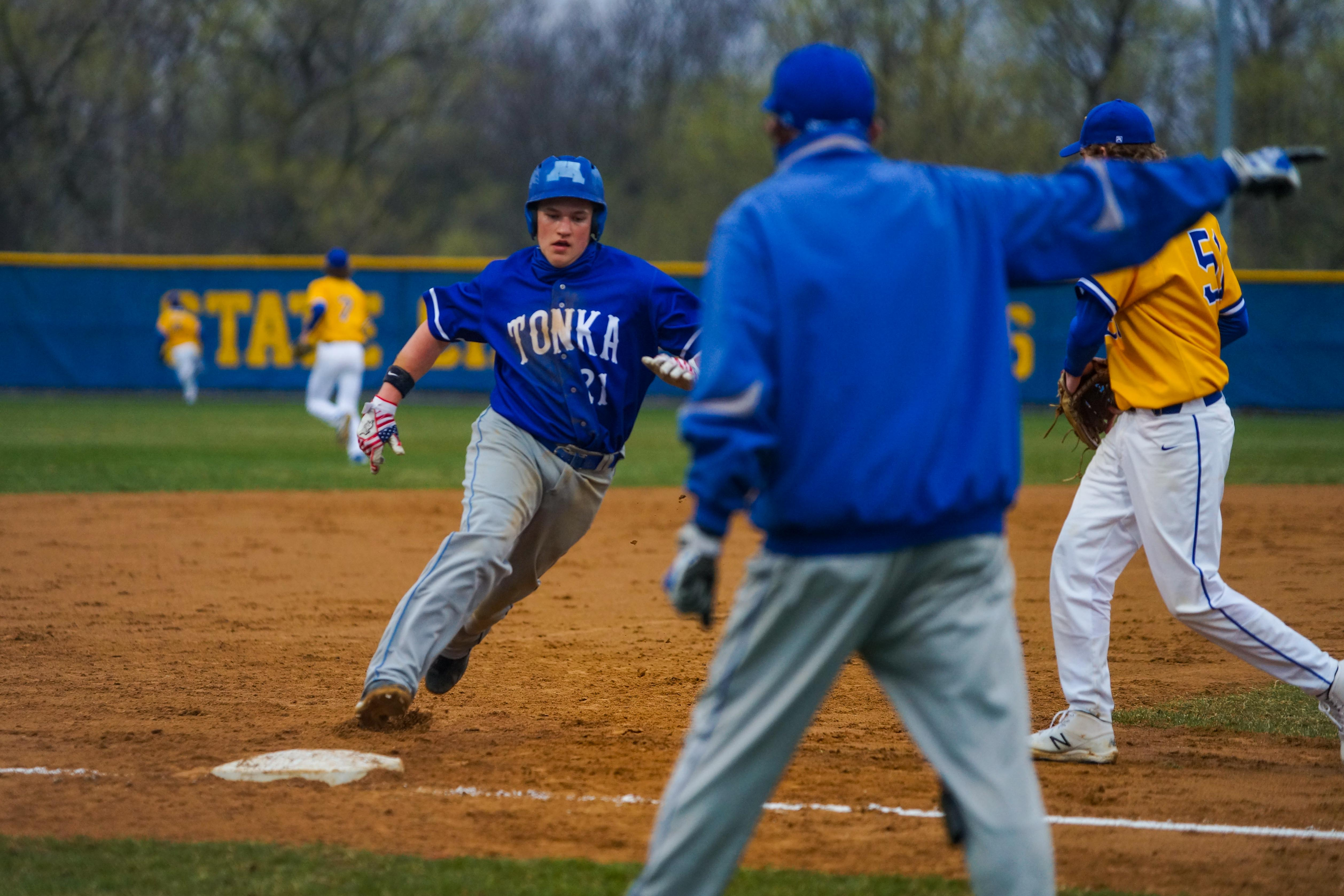 Minnetonka coach Paul Twenge sends a runner around third during the second inning to score the Skippers' only run of the game in in a 4-1 loss Friday at Wayzata. Photo by Korey McDermott, SportsEngine