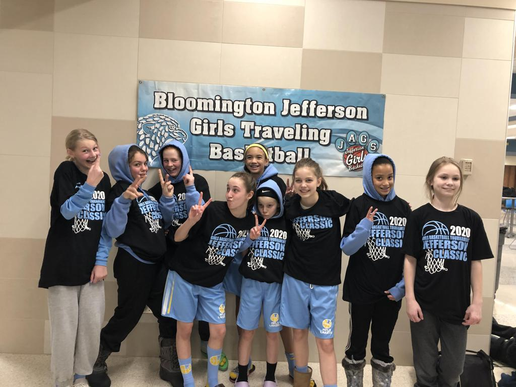 Mpls Lakers Youth Traveling Basketball Program Inc Girls 6th Grade Blue pose with their T-Shirts after placing 2nd at the Bloomington tournament in Bloomington, MN