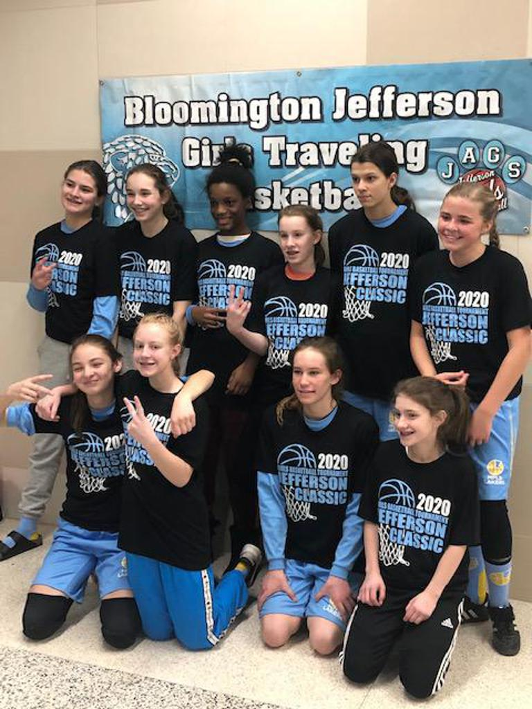 Mpls Lakers Youth Traveling Basketball Program Inc Girls 7th Grade Gold pose with their T-Shirts after placing 2nd at the Bloomington tournament in Bloomington, MN