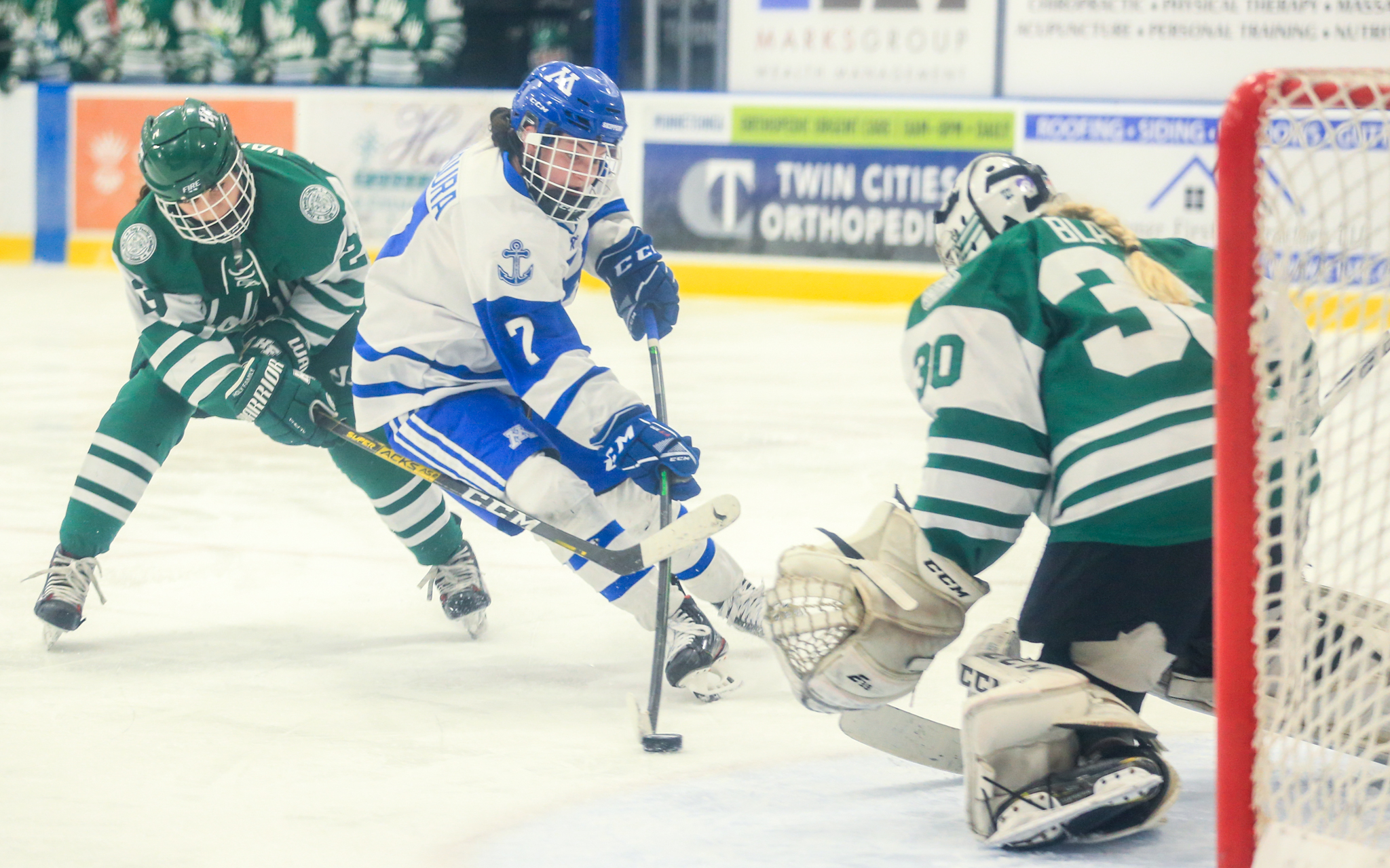 Minnetonka's Grace Sadura (7) gets off a shot for a third period goal against Holy Family Catholic Saturday evening. Sadura added an assist in the Skippers' 4-1 victory over the fire. Photo by Jeff Lawler, SportsEngine