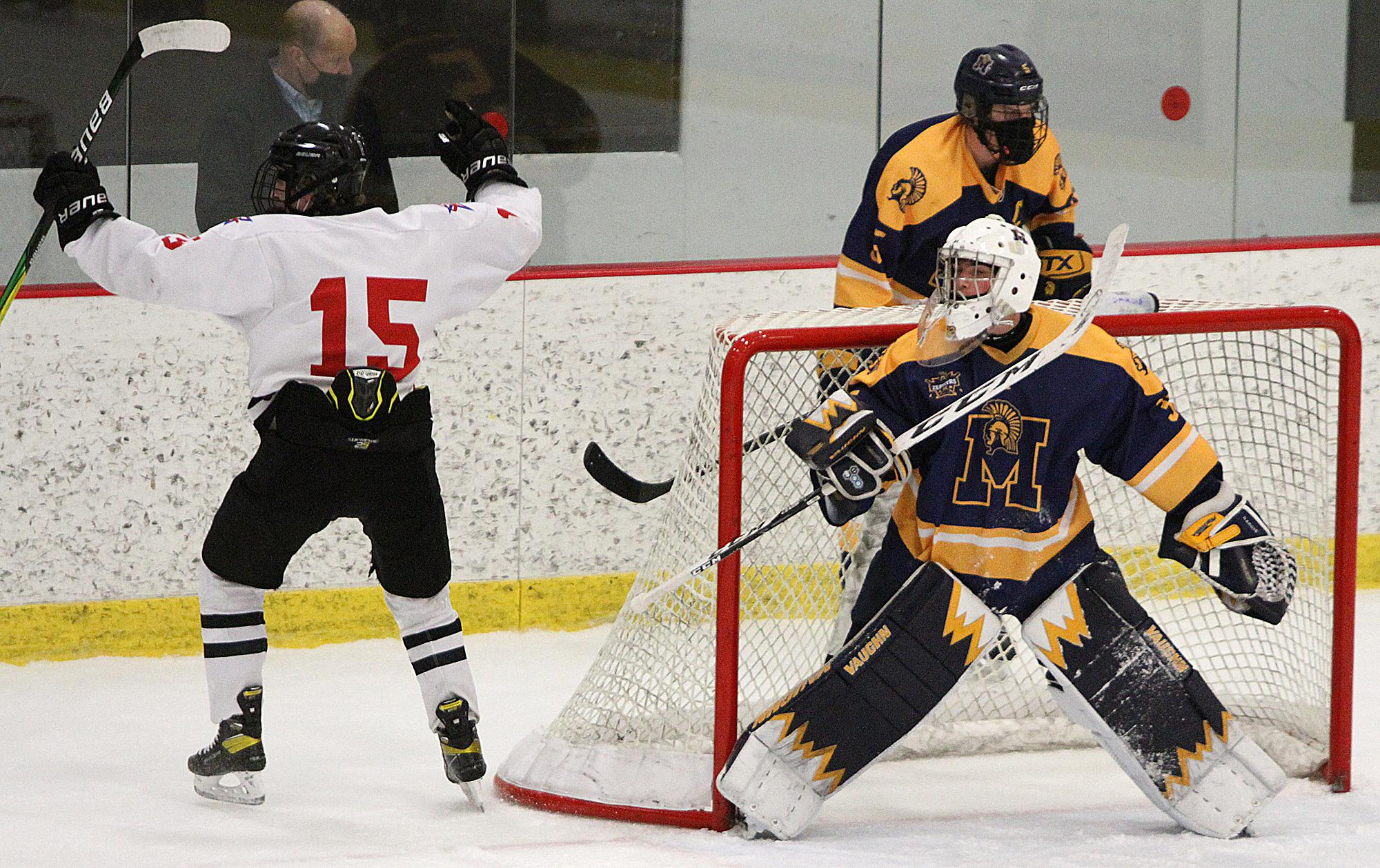 Gentry Academy junior wing Barrett Hall slips a wrist shot past Mahtomedi goaltender Ben Dardis for a third-period goal Thursday night as the host Stars triumphed with a 7-3 victory. Photo by Drew Herron, SportsEngine