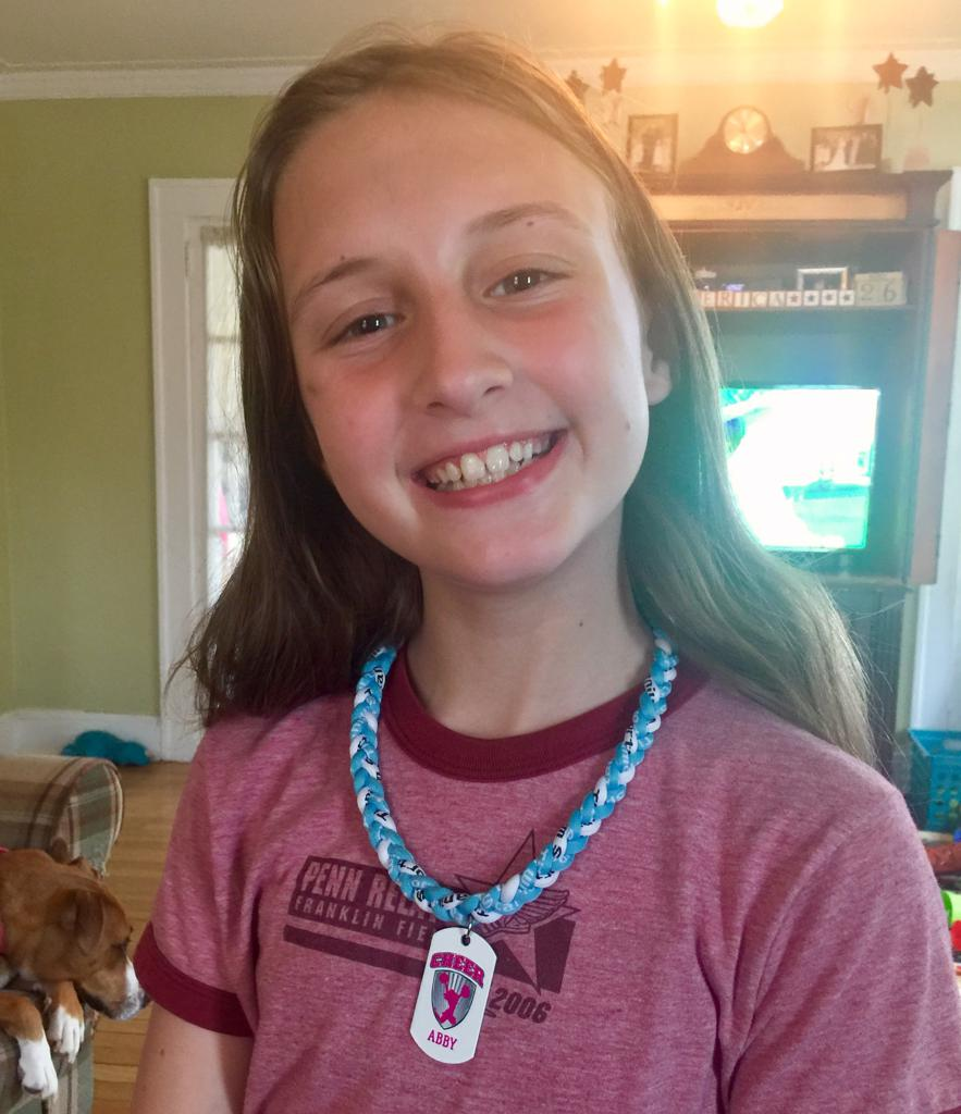 Abby loving her new custom Cheerleading Dog Tag!