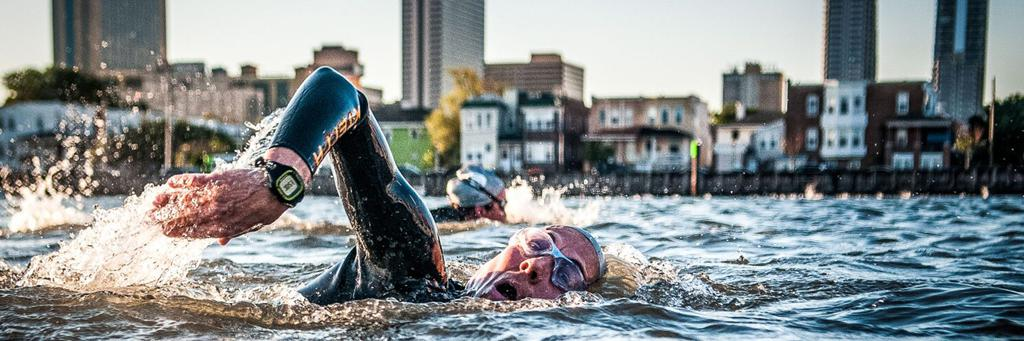 Swimmers participating in a IRONMAN 70.3 race