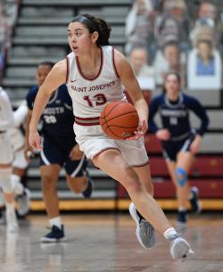 Mary Sheehan dribbles a basketball