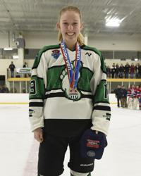 Joslin Mumm, who scored game-winning goal, accepts her championship medal