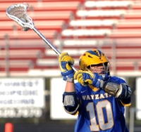 Andrew Fairbairn of Wayzata and the rest of the Trojans ran into a red-hot Maple Grove Crimson squad on Thursday, May 26. Fairbairn notched his 21st point of the season -- an assist -- in the game. Photo by Helen Nelson (Courtesy of the MN Lax Hub)