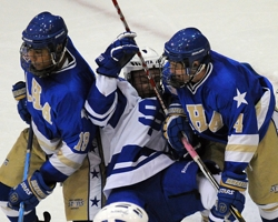 Andrew Commers took on two Holy Angels defensemen during the Cadets' 9-3 victory Monday.