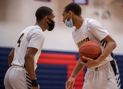 Two basketball player speak to each other