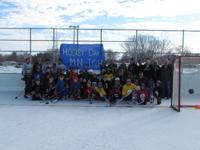 Youth players from Inver Grove Heights celebrate Hockey Day Minnesota on outdoor ice