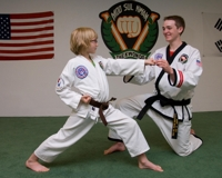 Learning martial arts in a kids taekwondo class