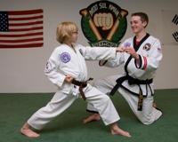 Learning martial arts in a kids taekwondo class
