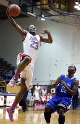 Bowsher's Nate Allen, left, goes to the net against Woodward's Anthony Bell, Jr., during a City League semifinal game.