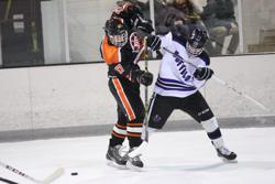 James McNamara battles with a Tiger defenseman during the Bison win.