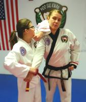 Teens learning martial arts for self defense