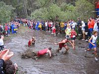 A cross country race in Seaside, Oregon. Some races may contain obstacles, like the standing water pictured here.