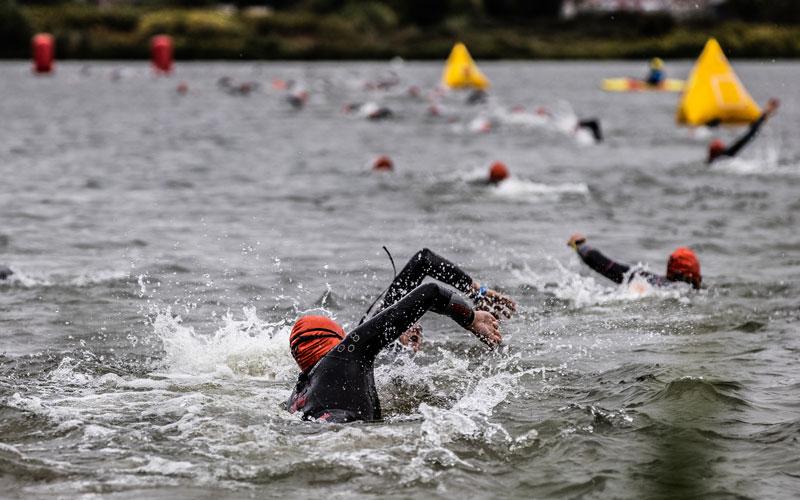 Athletes swimming in the Maas at IRONMAN Maastricht-Limburg