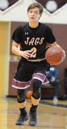 Carl Schaller dribbles a basketball