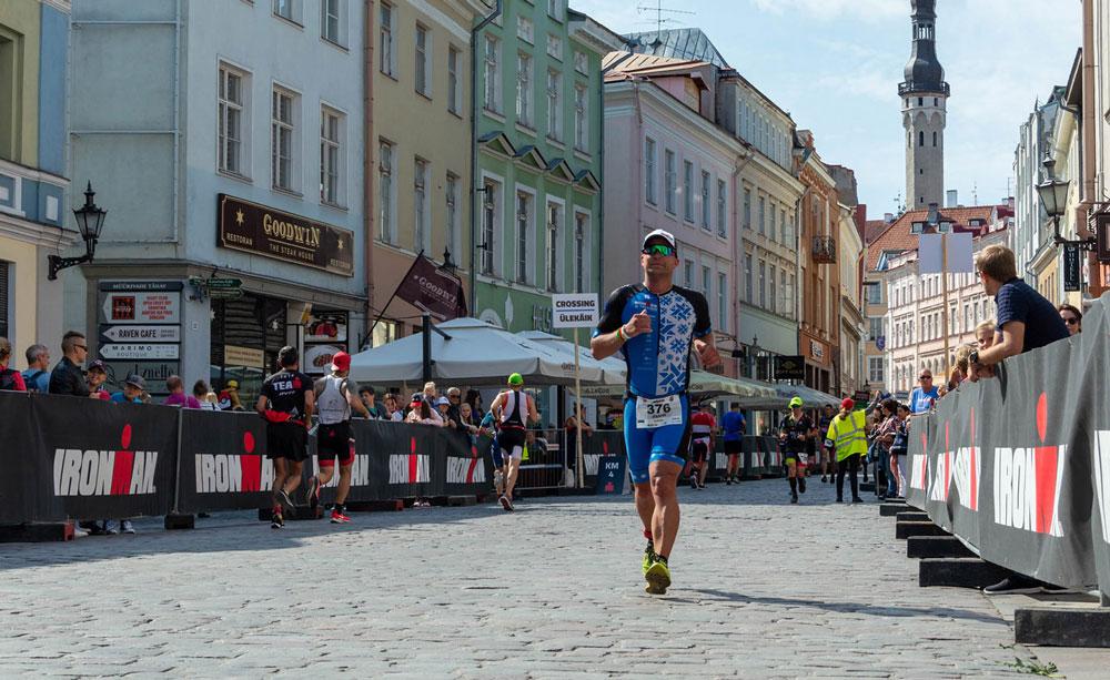 Athlete running through the old town at IRONMAN Tallinn