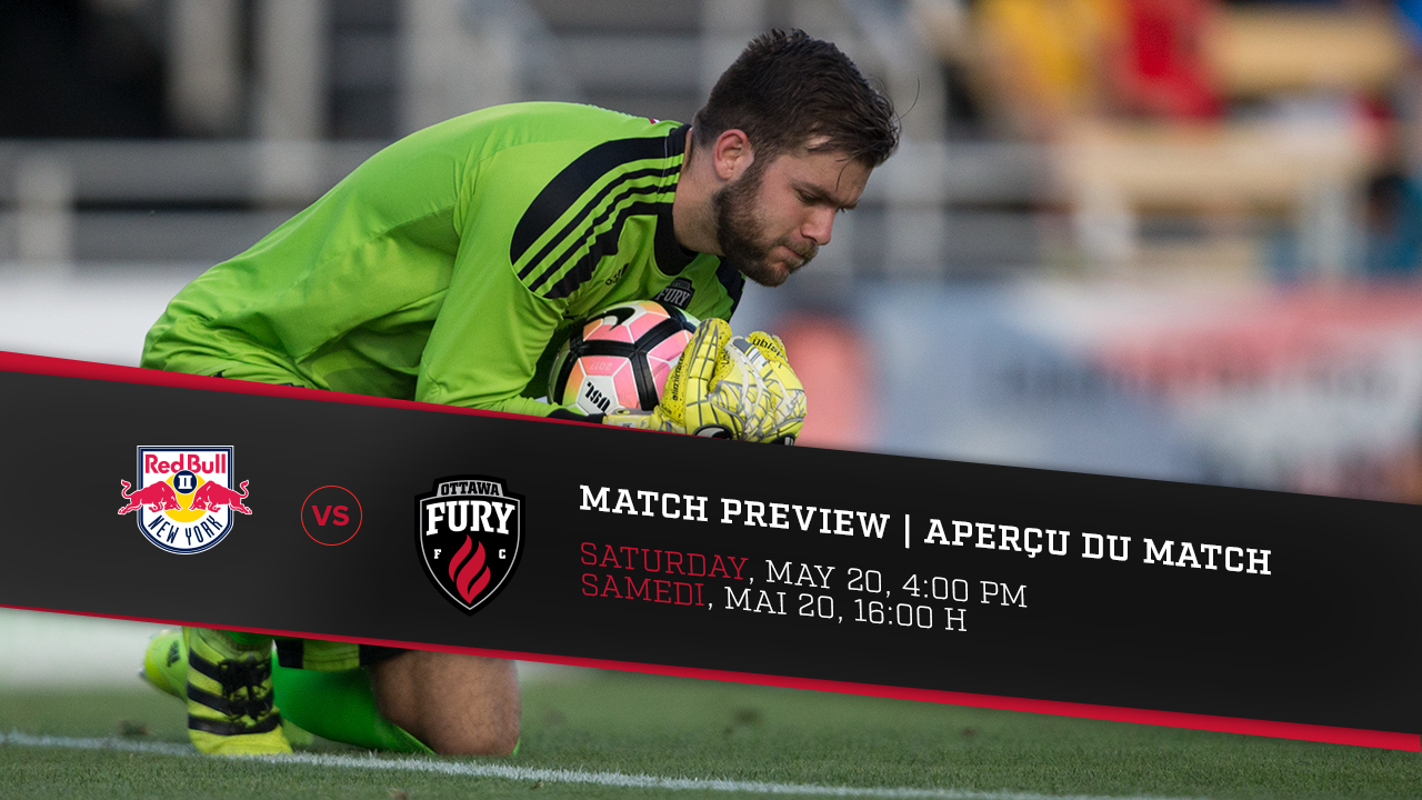 Callum Irving picking up a ball on the ground during a Fury FC game
