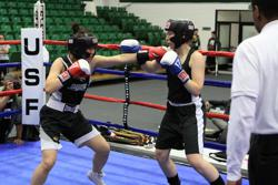 Two women boxers competing