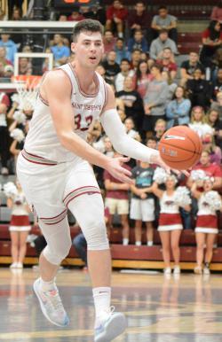 Taylor Funk dribbles a basketball