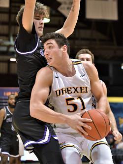 James Butler dribbles a basketball