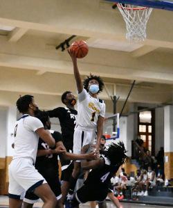 A boy shoots a basketball