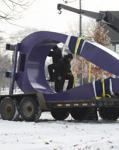 "Workers installed ""Purple Raindrop"" at Farview Park."