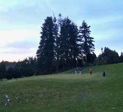 Ingraham Golfers under a sunset sky
